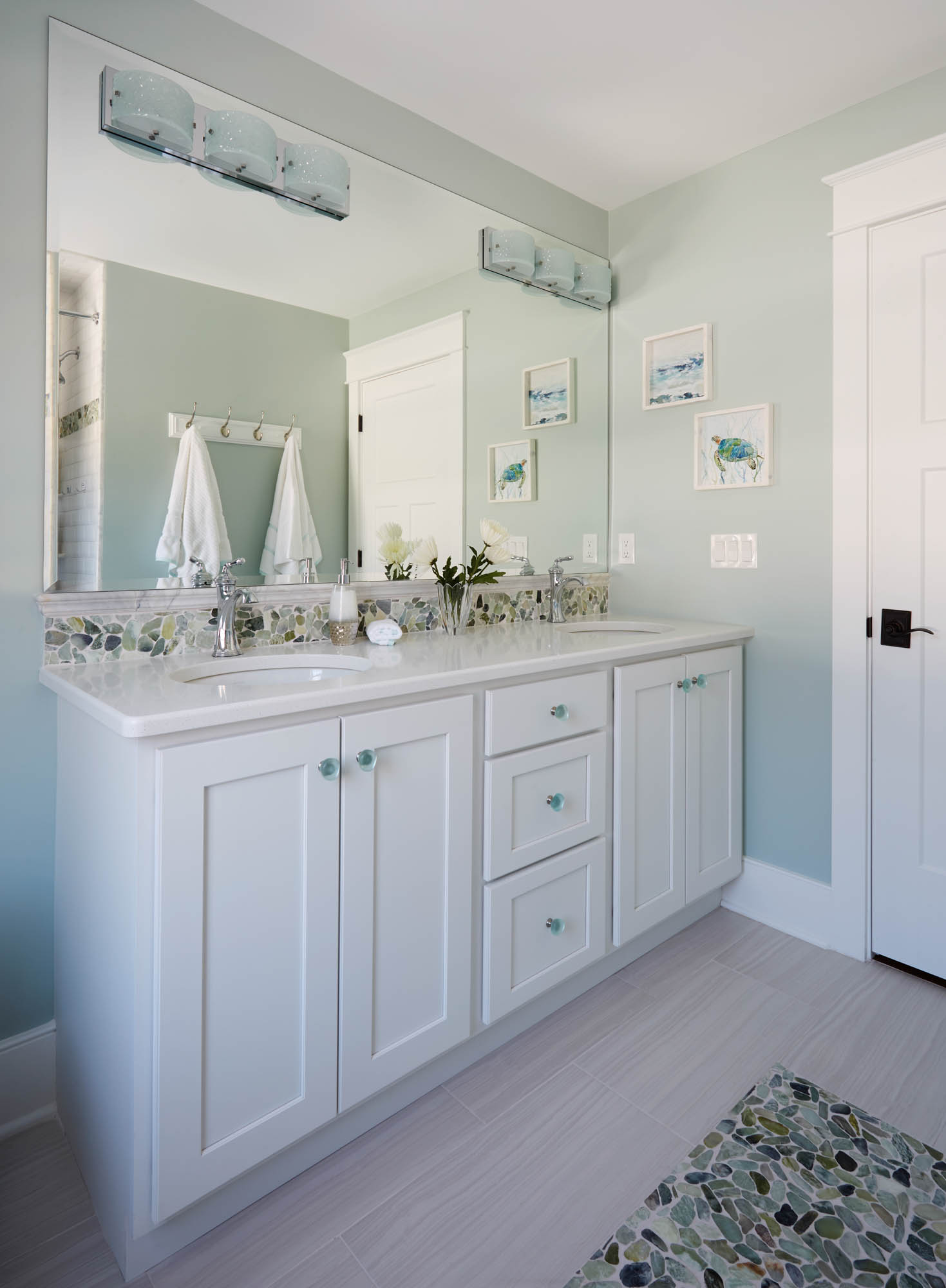 Painted guest bathroom cabinets in Extra White