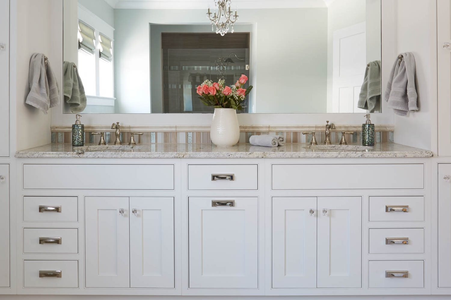 Painted master bathroom cabinets in Extra White