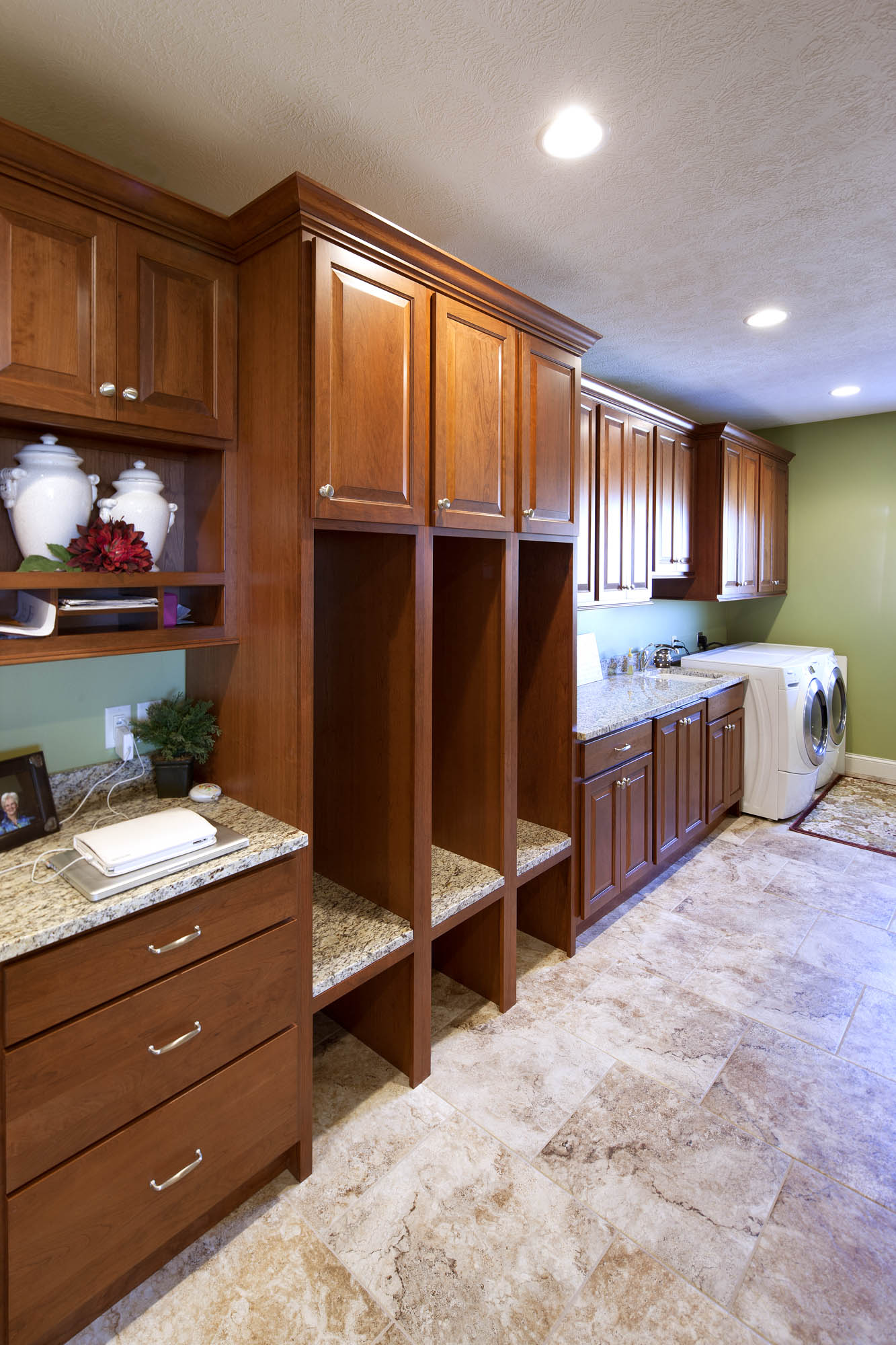 Stained laundry room cabinets in Autumn with Ebony Glaze