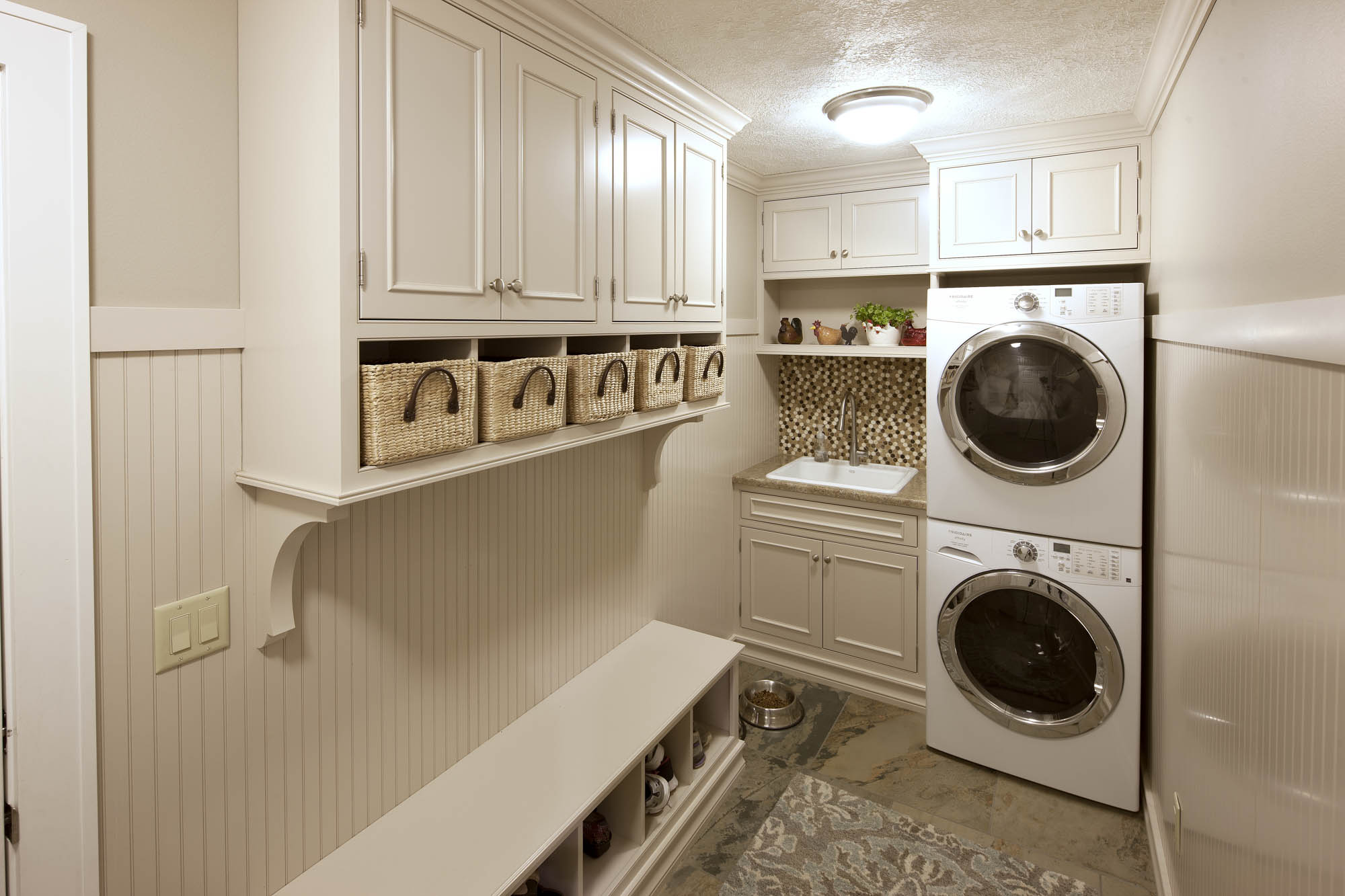 Painted laundry room cabinets in Light Mocha
