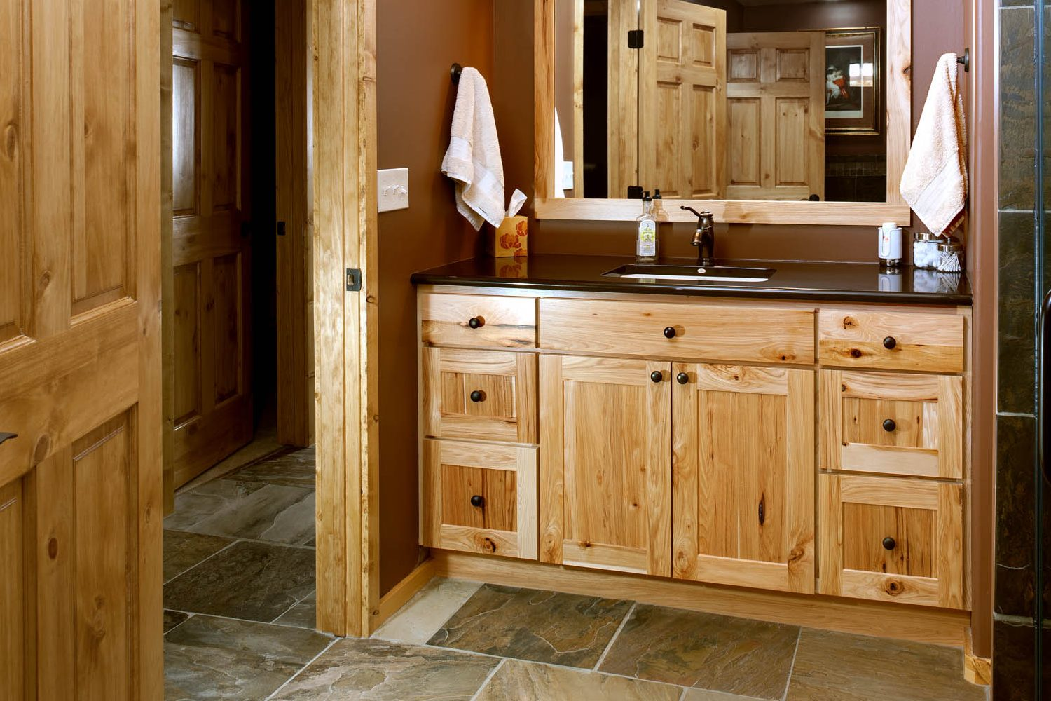 Stained guest bathroom vanity in Natural