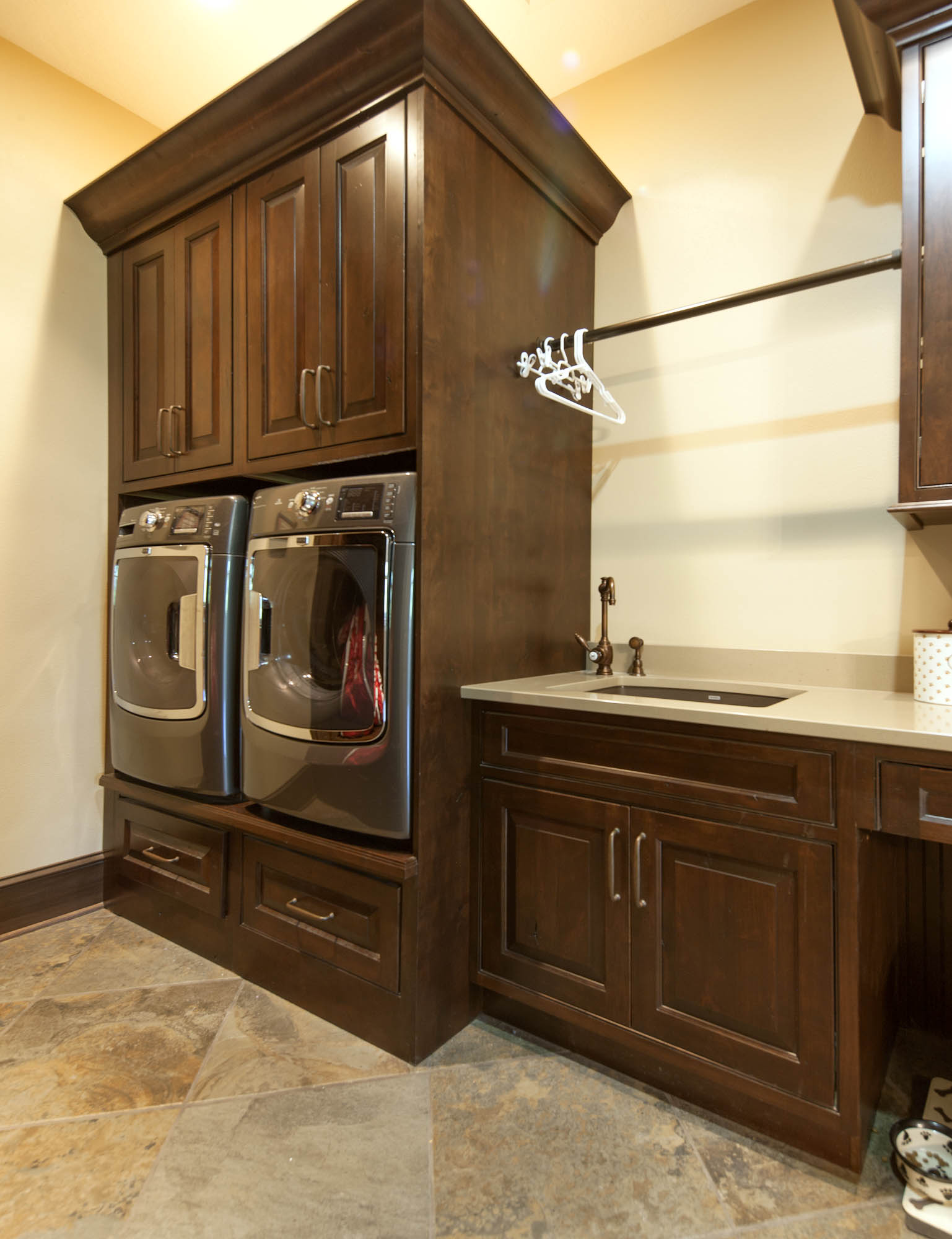 Stained laundry room cabinets in Distressed Coffee