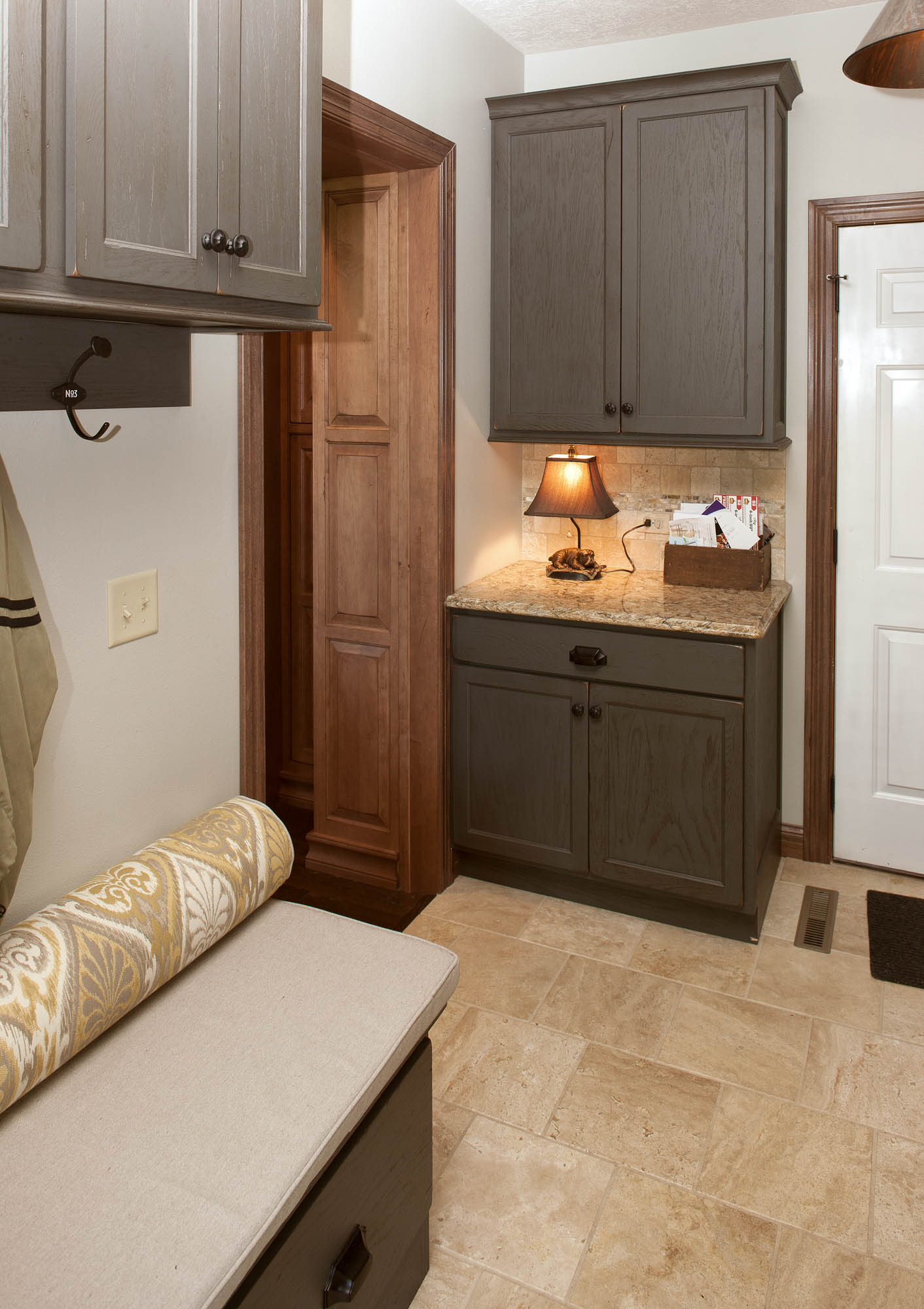 Painted laundry room cabinets in Vintage Graphite